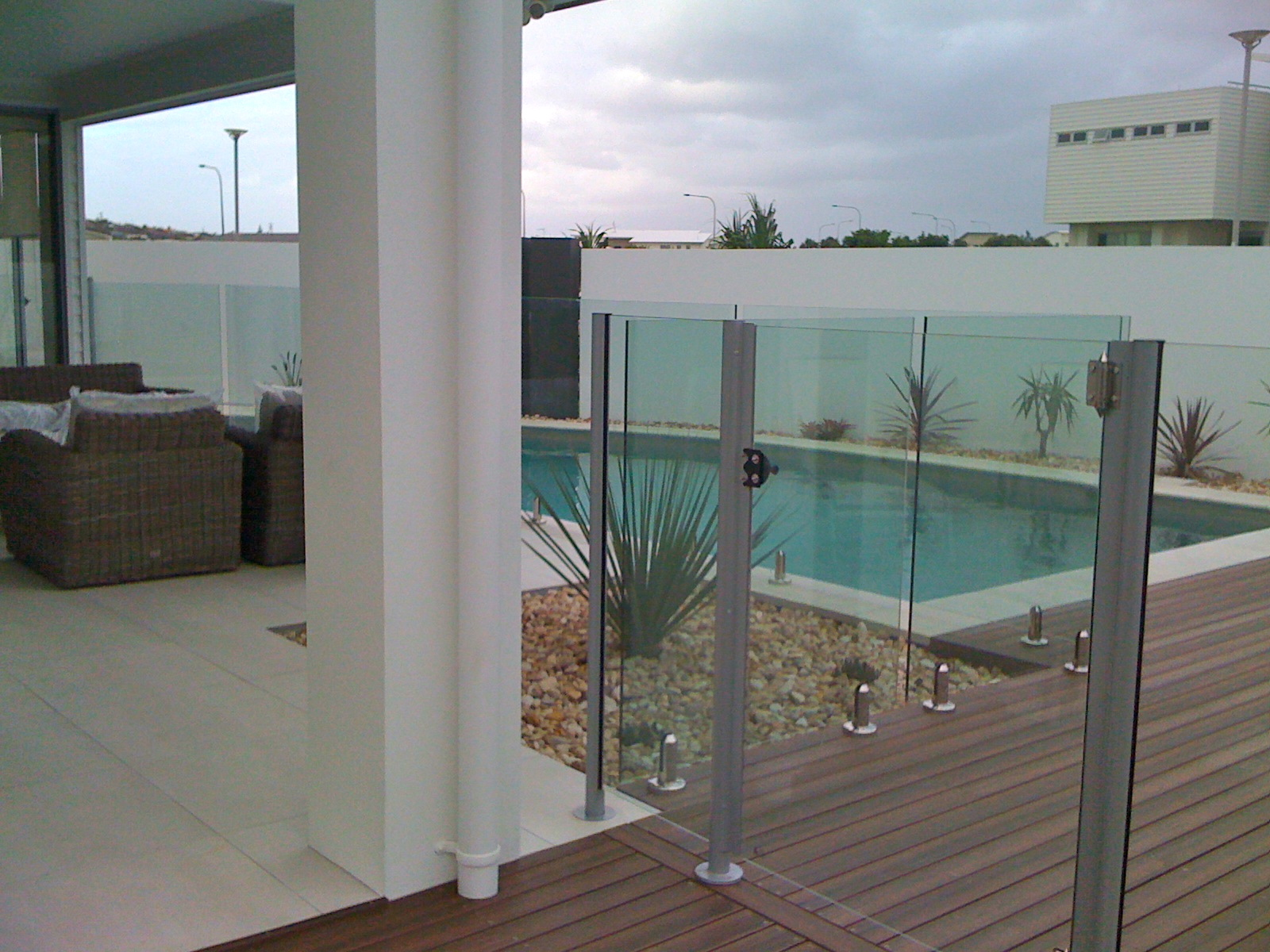 Semi frameless glass gate with pool fencing
